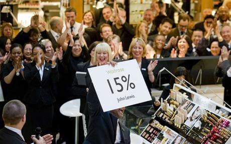 Staff celebrate their 15 per cent bonus.