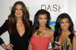 A picture of the Kardashian sisters smiling for a photo