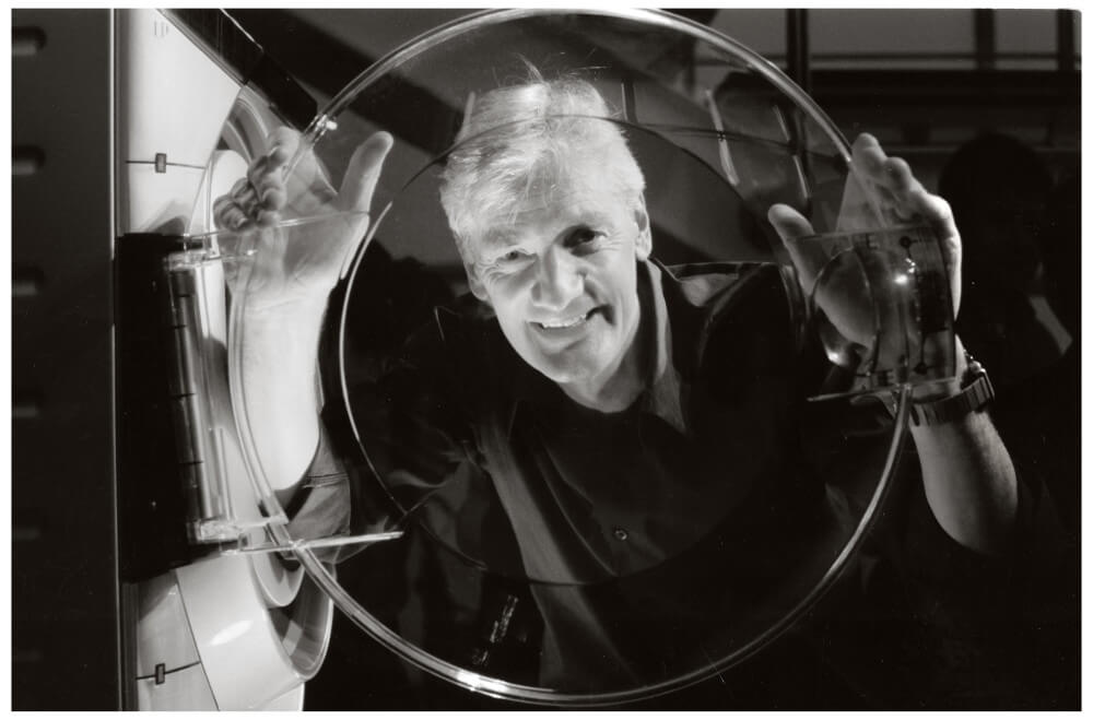 James Dyson smiling at a camera in a black and white picture