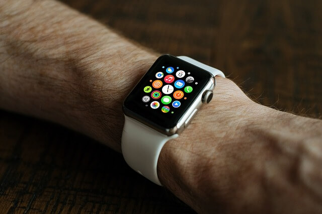 A picture of someone wearing an Apple smartwatch