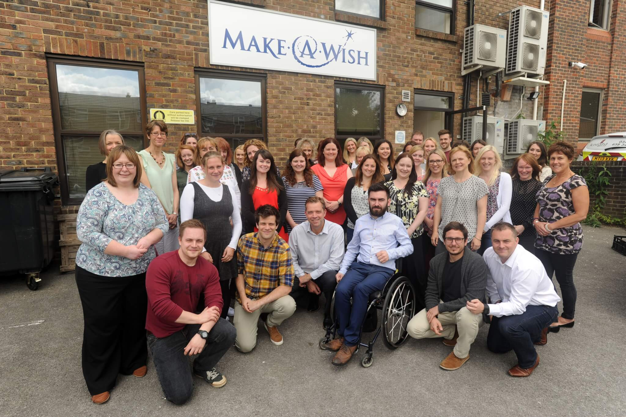Make A Wish staff on the 30th anniversary outside of the Make A Wish office