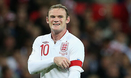 Wayne Rooney playing at Wembley for England with captains armband The PHA Group