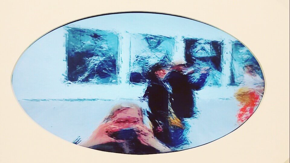 A painting in a oval shape with someone taking a picture on a mobile