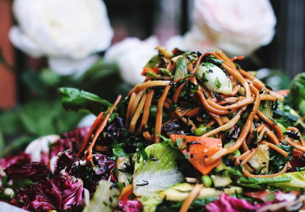 A close up picture of a salad with carrots