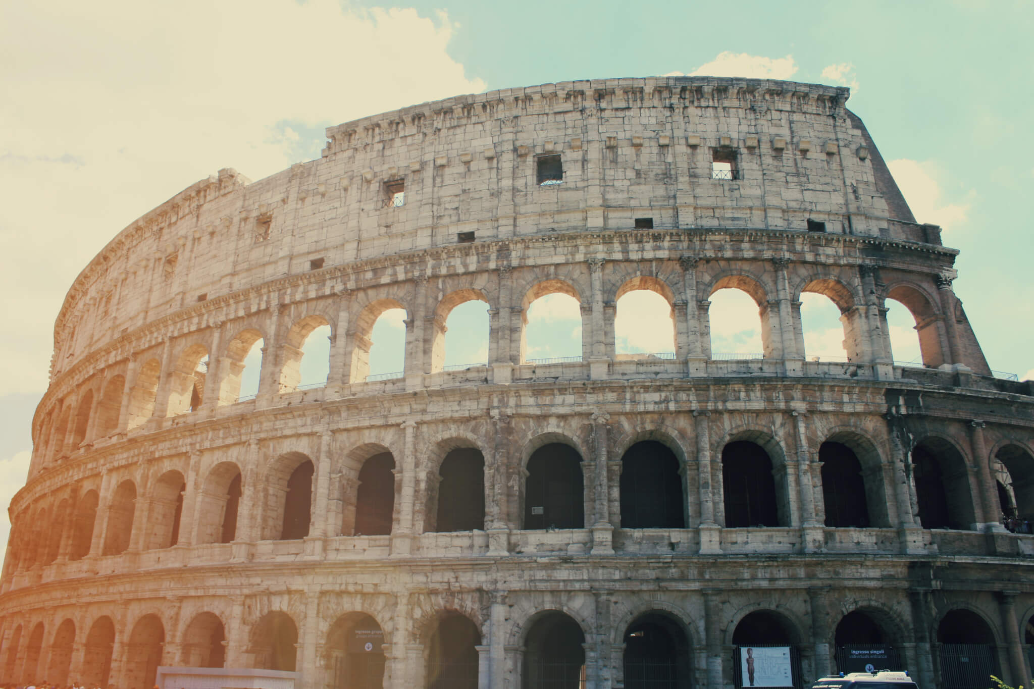 The Colosseum on a sunny day with blue skies