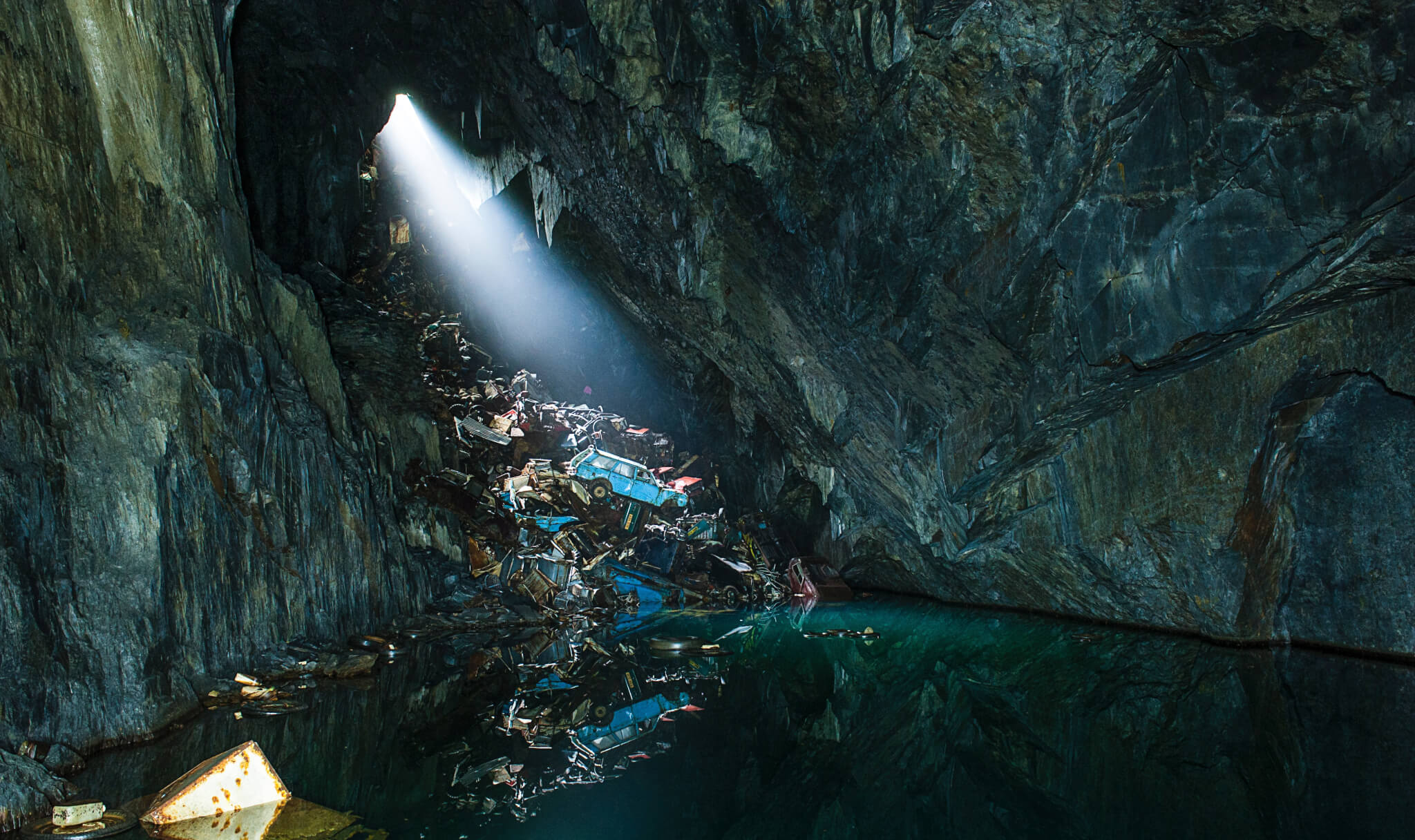 A picture of a cave filled with rubbish