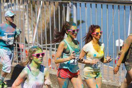 A picture of someone running the colour race