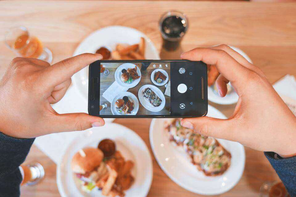 A picture of someone taking a picture of their food
