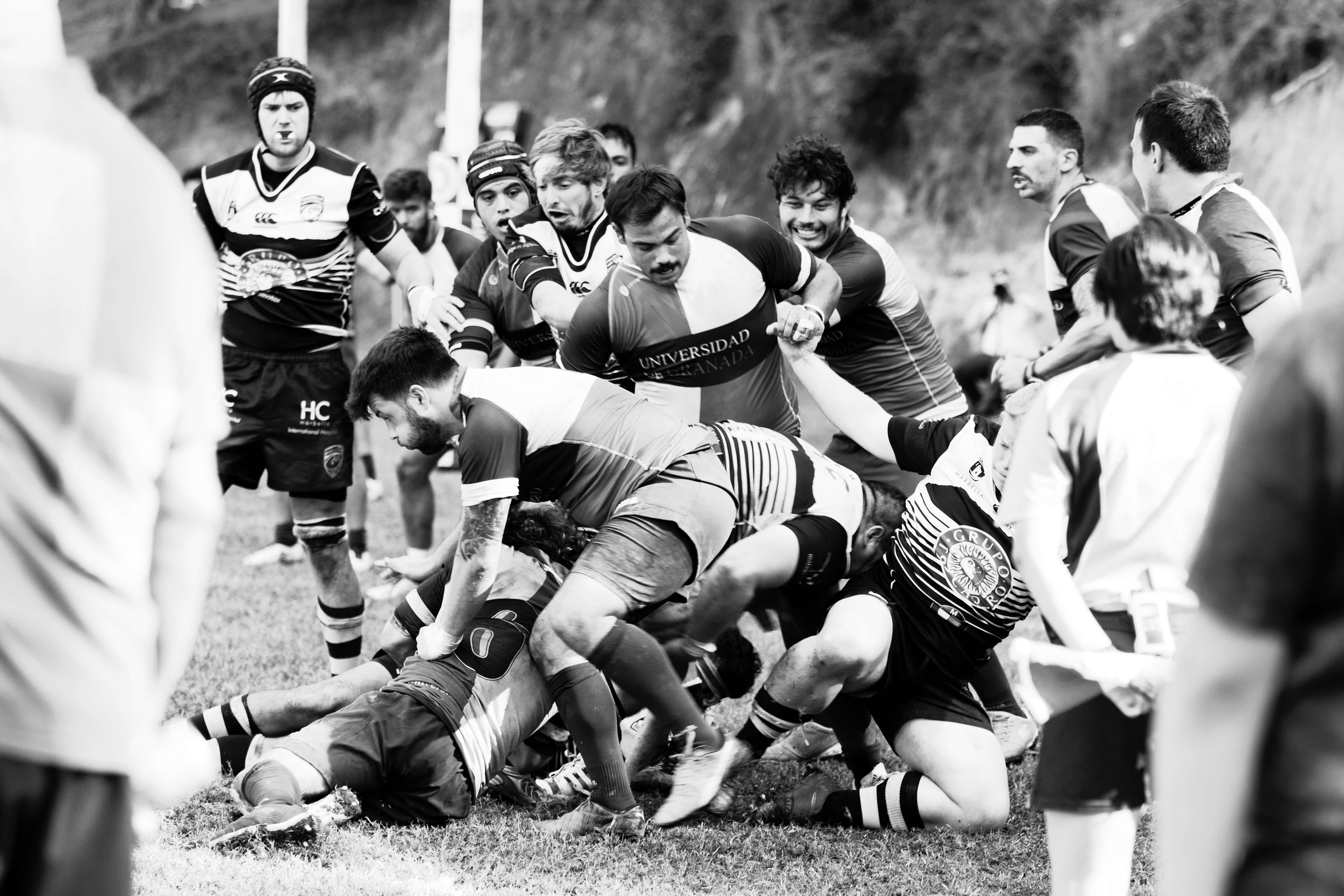 A picture of a rugby scrum in a black and white imagery