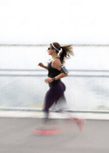 Woman running black outfit