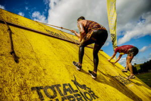 Total Warrior ascending over a wall
