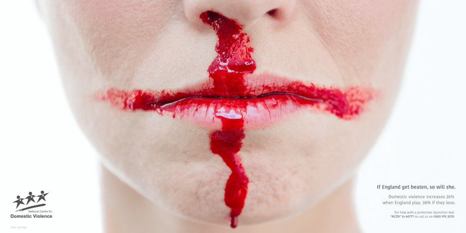 National Centre for Domestic Violence advert of a lady with a bloody nose turned into an England flag