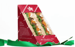 A picture of a Pret Christmas sandwich with a green ribbon around it