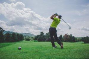 golf shot driving off tee