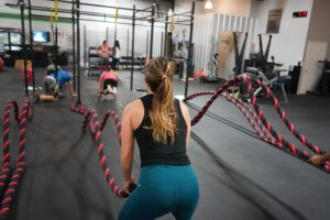 a women using ropes in a gym during an exercise class