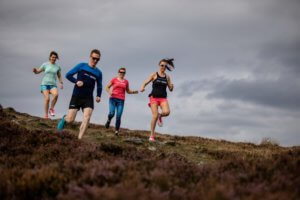 A group of fitness fanatics running down a mountain