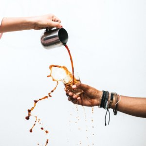 Coffee being poured into a cup artfully