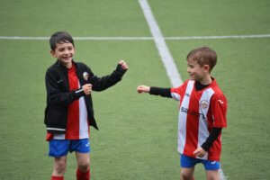 two children playing football