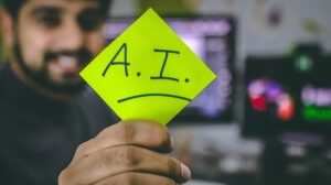 Artificial intelligence sticker being held up