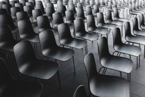 Empty chairs lined up in rows