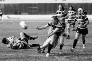 black and white picture of women's rugby match
