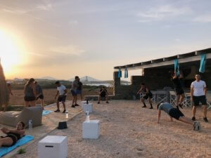 crossfit taking place outside in the sun