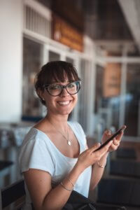 a lady holding a mobile phone