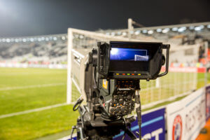 TV camera at the stadium during football matches. television camera during the soccer match