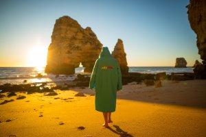 dryrobe jacket on the beach