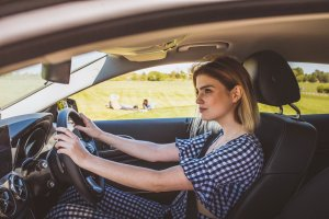 A lady driving a car